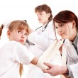 Group doctor treat happy child. First aid. — Stock Photo