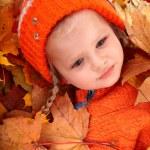 Child girl in autumn orange leaf. — Stock Photo #3584431