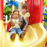 Children on slide outdoor in park. — Stock Photo #3584509