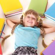 Stock Photo: Child with open book lying on floor.
