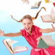 Schoolgirl holding pile of books. — Stock Photo