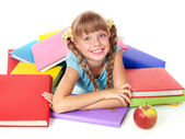 Child with pile of books and apple. — Stock Photo