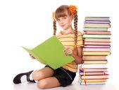 Schoolgirl holding pile of books. — Stock Photo