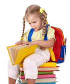 Child sitting on pile of books. — Stock Photo