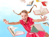 Schoolgirl holding pile of books. — Foto Stock