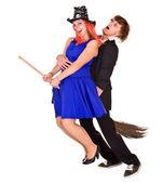 Halloween girl witch on broom bear man. — Stock Photo