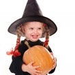 Child girl in costume Halloween witch with pumpkin, broom. — Stockfoto #3900646