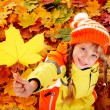 Royalty-Free Stock Photo: Child in autumn orange leaves.