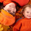 Happy family with child on autumn orange leaf. — Stock Photo #3900702