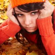 Girl in orange hat on leaves. Autumn depression. — Stock Photo #3900705