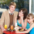 Happy family with child in cafe. — Stock Photo #3900920