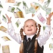 Child with flying money. — Stock Photo