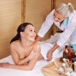 Young woman on massage table in beauty spa. Series. — Stock Photo #3901146