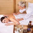 Young woman on massage table in beauty spa. — Stock Photo #3901152