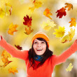 图库照片: Girl in autumn orange hat with outstretched arm.
