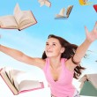 Student girl holding pile of books. — Stock Photo