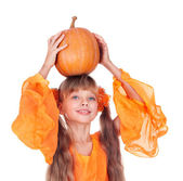 Girl in orange long dress with pumpkin at thanksgiving. — Stock Photo