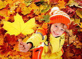 Child in autumn orange leaves. — Stock Photo