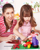 Mother and the daughter mould from plasticine. — Stock Photo