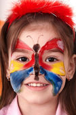 Child making face painting. — Stock Photo