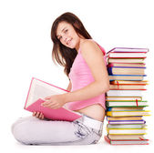 Girl with pile colored book. — Stock Photo