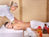 Young woman on massage table in beauty spa. Series. — Foto Stock