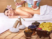 Young woman on massage table in beauty spa. — Foto Stock