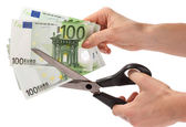 Euro banknote cut with scissors. — Stock Photo