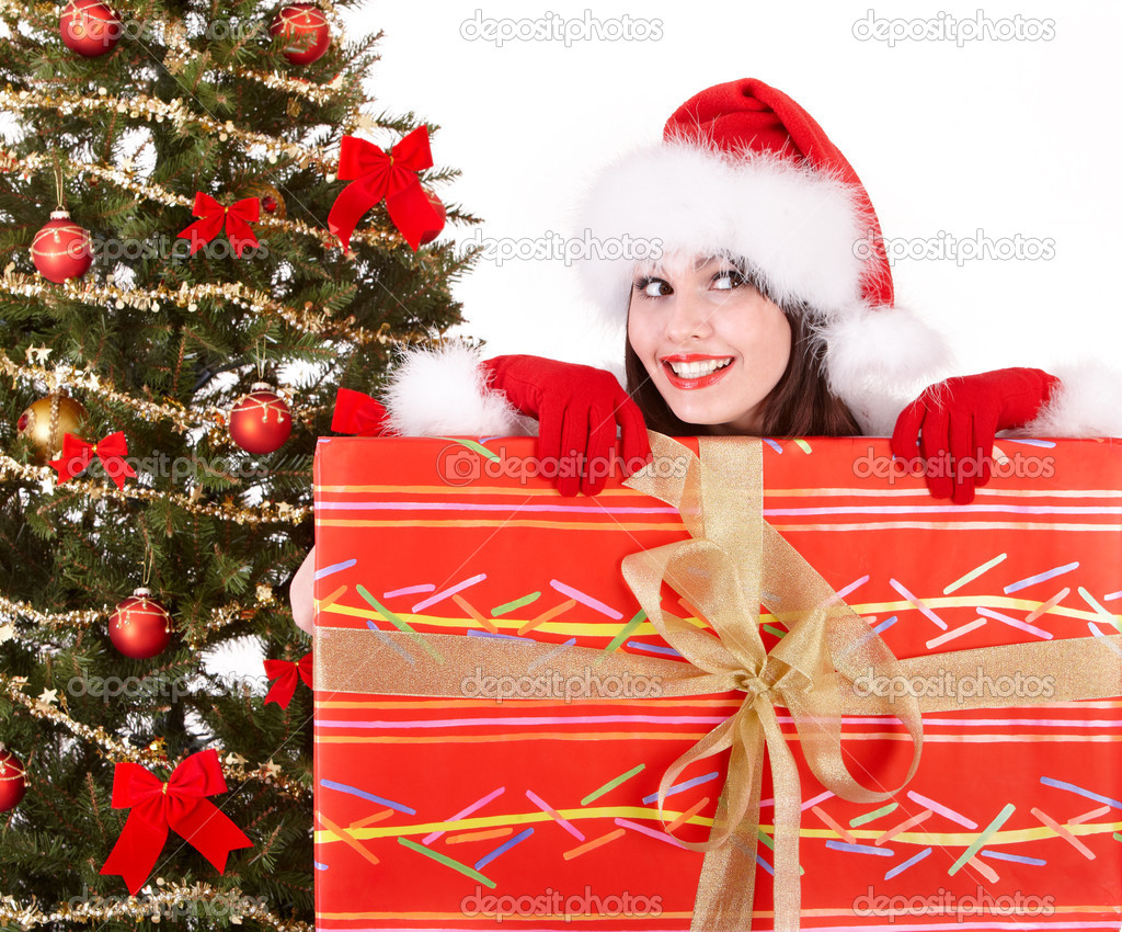 Christmas girl in santa hat and fir tree with red gift box. Isolated. — Stock Photo #3900710