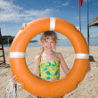 Stockfoto: Childl with life buoy at coast.