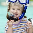 Child learn to swim . - Stock Photo