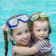 Stock Photo: Children swim in swimming pool.