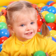 Постер, плакат: Child in group colourful ball