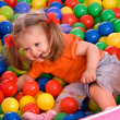 Child in group colored ball. — Stock Photo