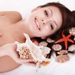 Beauty young woman holding starfish. — Stock Photo