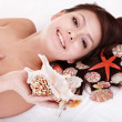Beauty young woman holding starfish. - Stock Photo