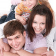 Happy family on white bed. — Stock Photo #3915600
