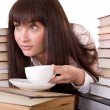 Girl with stack book and cup. — Stock Photo