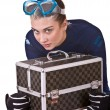 Girl in goggles with box. — Stock Photo
