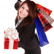 Stock Photo: Girl in business suit with gift box and shopping bag.