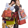 Royalty-Free Stock Photo: Two beautiful girlfriends enjoy shopping.