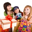 Three beautifu girlfriends enjoy shopping. - Stock Photo
