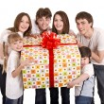 Happy family with gift box. — Stock Photo