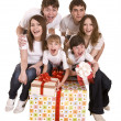 Happy family with gift box. — Stock Photo