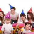 Stock Photo: Happy family with children in party hat.