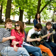 Group of in city park listen music. — Stock Photo #3916310