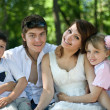 Stock Photo: Family and children on bench in park.