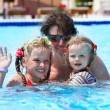 Happy family in swimming pool. — Stock Photo