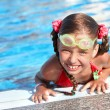 Child with protective goggles in swimming pool. — Stock Photo #3916395