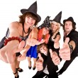 Stock Photo: Group of in witch costume with thumbs up.